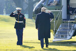 President Donald Trump walks to board Marine One on the South Lawn of the White House, Tuesday, Jan. 12, 2021 in Washington. The President is traveling to Texas. (AP Photo/Gerald Herbert)
