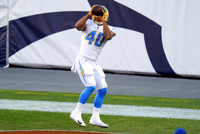 Los Angeles Chargers running back Gabe Nabers (40) pulls in a touchdown pass against the Denver Broncos during the first half of an NFL football game, Sunday, Nov. 1, 2020, in Denver. (AP Photo/Jack Dempsey)