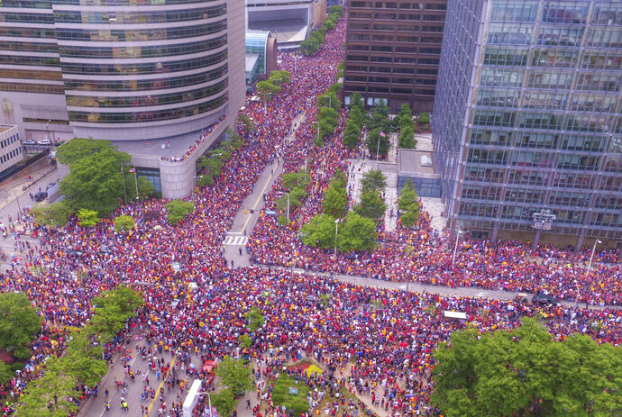 In this June 22, 2016 photo, the crowd wait in the parade route in downtown Cleveland to celebrate the Cavaliers basketball team's NBA championship. This photo showing a crowd of nearly one million people engulfing major roadways was not taken during a President Donald Trump rally in Houston this week, as several people falsely claimed on social media.But the image circulating on social media was snapped in June 2016 during a million-person parade that took place in downtown Cleveland to celebrate the Cavaliers' NBA championship. Using a drone, Bruce Bishop and Matt Mishak took the photo while covering the event for the Chronicle-Telegram, a newspaper in Elyria, Ohio. (Bruce Bishop/Elyria Chronicle-Telegram via AP)