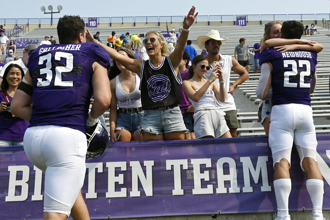 Northwestern linebacker Bryce Gallagher (32) is greeted by a fan after an NCAA college football game against Indiana State in Evanston, Ill., Saturday, Sept. 11, 2021. (AP Photo/Matt Marton)