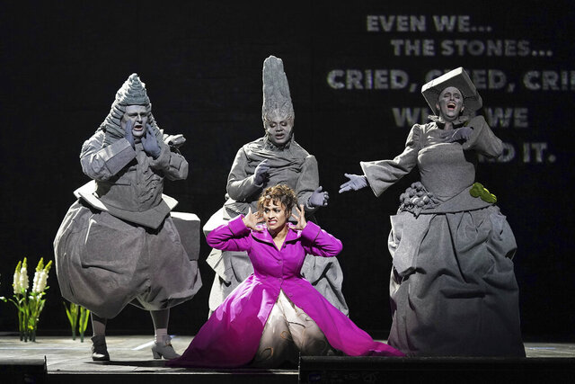 This Jan. 25, 2020 photo released by the LA Opera shows Danielle de Niese, foreground center, with Kevin Ray, background from left, Raehann Bryce-Davis and Stacey Tappan as the Three Stone sduring a dress rehearsal of
