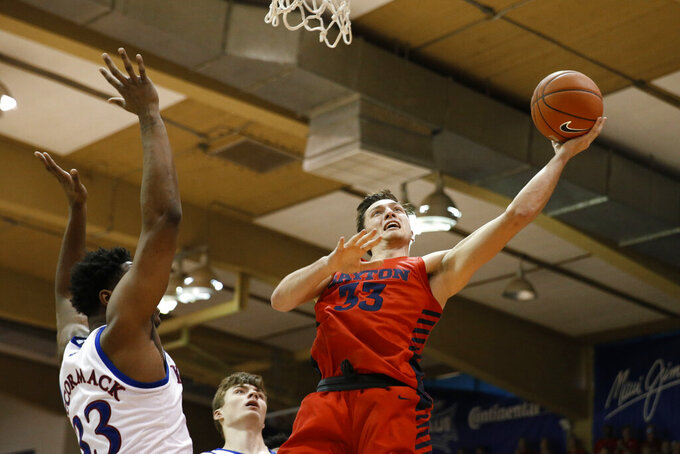 Dayton forward Ryan Mikesell (33) shoots next to Kansas forward David McCormack (33) during the first half of an NCAA college basketball game Wednesday, Nov. 27, 2019, in Lahaina, Hawaii. (AP Photo/Marco Garcia)