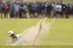 Northern Ireland's Rory McIlroy plays out of a bunker on the 7th green during the second round of the British Open Golf Championship at Royal St George's golf course Sandwich, England, Friday, July 16, 2021. (AP Photo/Ian Walton)