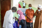 Djiboutians queue to cast their votes in the presidential election, in the capital Djibouti city, Djibouti, Friday, April 9, 2021. The Horn of Africa country of Djibouti is going to the polls on Friday as President Ismail Omar Guelleh seeks a fifth term in the small but strategically important nation home to military bases for the United States, China and others. (AP Photo/Mahad Mohamed)