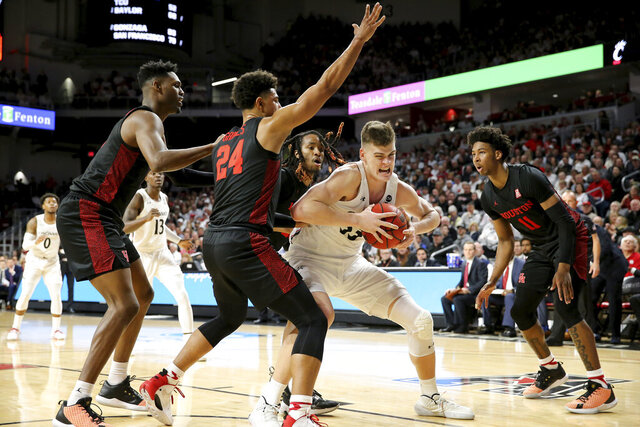 Cincinnati center Chris Vogt (33) competes for a position as Houston guard Quentin Grimes (24) defends in the first half of an NCAA college basketball game, Saturday, Feb. 1, 2020, in Cincinnati. (Kareem Elgazzar/The Cincinnati Enquirer via AP)