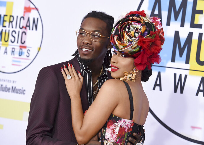 "FILE - In this Oct. 9, 2018, file photo, Offset, left, and Cardi B arrive at the American Music Awards at the Microsoft Theater in Los Angeles.   Cardi B has filed for divorce from Offset, claiming her marriage was ""irretrievably broken."" A Fulton County Courthouse filing states that she filed the divorce documents Tuesday in Atlanta. (Photo by Jordan Strauss/Invision/AP, File)"