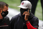 Atlanta Falcons head coach Raheem Morris speaks during the first half of an NFL football game between the Atlanta Falcons and the Detroit Lions, Sunday, Oct. 25, 2020, in Atlanta. (AP Photo/Brynn Anderson)