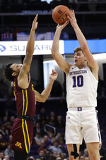 Northwestern forward Miller Kopp, right, shoots against Minnesota guard Payton Willis during the second half of an NCAA college basketball game in Evanston, Ill., Sunday, Feb. 23, 2020. (AP Photo/Nam Y. Huh)