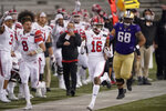 Utah safety Zemaiah Vaughn (16) runs 73 yards as quarterback Jake Bentley (8) runs next to him on the sideline after Vaughn intercepted a Washington pass during the first half of an NCAA college football game Saturday, Nov. 28, 2020, in Seattle. (AP Photo/Ted S. Warren)