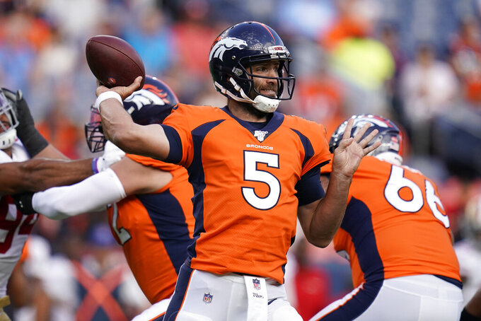 FILE - In this Aug. 19, 2019, file photo, Denver Broncos quarterback Joe Flacco (5) throws a pass against the San Francisco 49ers during an NFL preseason football game in Denver. More than ever NFL teams are choosing protection over preparation when it comes to their quarterback's workload in the preseason. The Broncos and Raiders, who cap off the NFL's opening weekend Monday night, are two examples. Oakland's Derek Carr took just six snaps and threw two passes in the preseason and Denver's new quarterback, Joe Flacco, directed just four series in the preseason. (AP Photo/Jack Dempsey, File)
