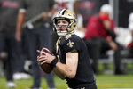 New Orleans Saints quarterback Drew Brees (9) works against the Tampa Bay Buccaneers during the first half of an NFL divisional round playoff football game, Sunday, Jan. 17, 2021, in New Orleans. (AP Photo/Brynn Anderson)