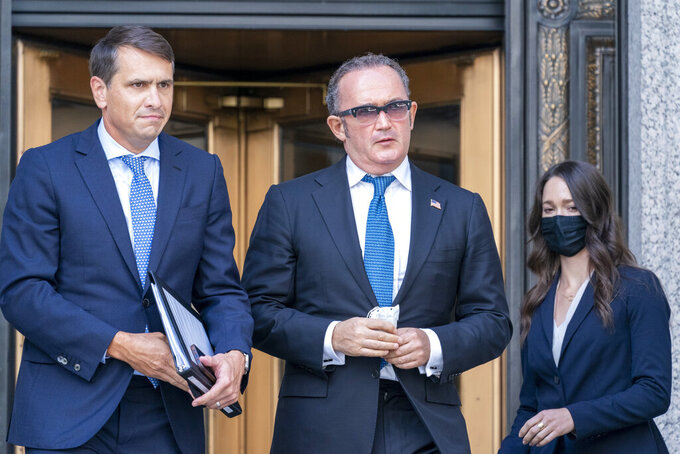 Igor Fruman, center, leaves in Federal court in Manhattan with his attorney Todd Blanche, left, Friday, Sept. 10, 2021. The Soviet-born Florida businessman who helped Rudy Giuliani seek damaging information about Joe Biden in Ukraine when Biden was running for president pleaded guilty in a case involving illegal campaign contributions. (AP Photo/Mary Altaffer)