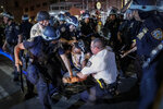 A protester is arrested on Fifth Avenue by NYPD officers during a march, Thursday, June 4, 2020, in the Manhattan borough of New York. Protests continued following the death of George Floyd, who died after being restrained by Minneapolis police officers on May 25. (AP Photo/John Minchillo)