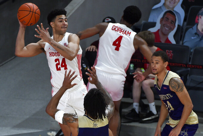 Houston guard Quentin Grimes (24) saves the ball from going out of bounds during the second half of an NCAA college basketball game against Alcorn State, Sunday, Dec. 20, 2020, in Houston. (AP Photo/Eric Christian Smith)