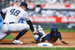 Cleveland Indians' Bradley Zimmer, right, dives safely into first base as New York Yankees' Anthony Rizzo tries to tag him out in the second inning of a baseball game, Sunday, Sept. 19, 2021, in New York. (AP Photo/Eduardo Munoz Alvarez)
