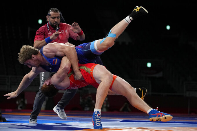 Russian Olympic Committee's Evloev Musa, bottom, and Armenia's Artur Aleksanyan compete during the men's 97kg Greco-Roman wrestling final match at the 2020 Summer Olympics, Tuesday, Aug. 3, 2021, in Chiba, Japan. (AP Photo/Aaron Favila)