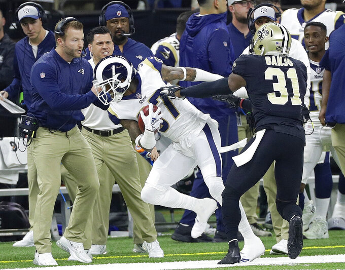 Los Angeles Rams' Sam Shields gets a first down on a fake punt during of the first half the NFL football NFC championship game against the New Orleans, Saints Sunday, Jan. 20, 2019, in New Orleans. (AP Photo/David J. Phillip)