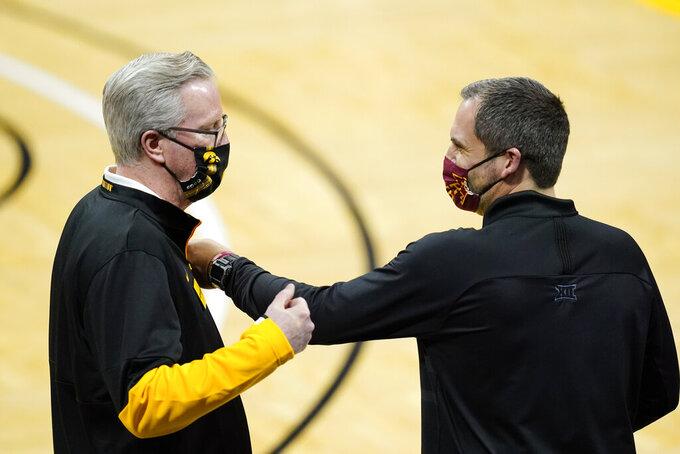 Iowa head coach Fran McCaffery, left, talks with Iowa State head coach Steve Prohm before an NCAA college basketball game, Friday, Dec. 11, 2020, in Iowa City, Iowa. (AP Photo/Charlie Neibergall)
