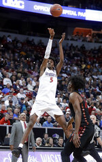 San Diego State's Jalen McDaniels shoots during the first half of the team's NCAA college basketball game against UNLV in the Mountain West Conference men's tournament Thursday, March 14, 2019, in Las Vegas. (AP Photo/Isaac Brekken)