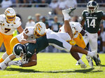 Michigan State's Cody White (7) is stopped by Arizona State's Erik Dickerson (93) and Evan Fields (4) during the first quarter of an NCAA college football game Saturday, Sept. 14, 2019, in East Lansing, Mich. (AP Photo/Al Goldis)