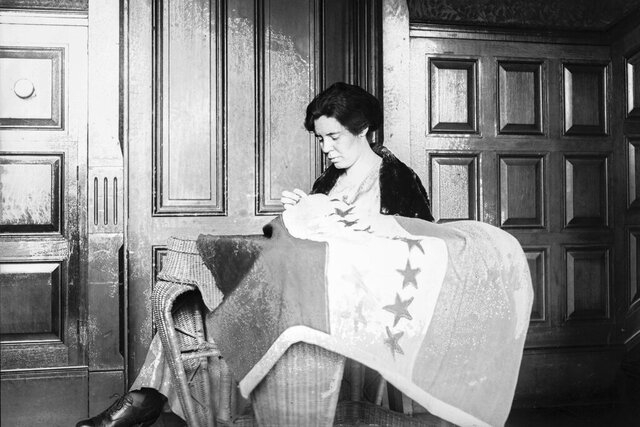 In this 1920s photo, Alice Paul sews a suffrage flag in Washington. One hundred years ago, American women gained the guaranteed right to vote, with ratification of the 19th Amendment. But to suffragist Paul, the vote wasn't enough. She equipped herself with a law degree and got to work writing another constitutional amendment — one that would guarantee women equal rights under the law. (National Photo Company Collection/Library of Congress via AP)