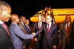 Foreign Minister of Germany Heiko Maas, center, is greeted by Sudanese officials as he walks  with Sudanese Undersecretary of the Foreign Ministry Omer Dahab Fadl Mohamed, right, at the Khartoum International Airport in Sudan, early Tuesday, Sept. 3, 2019. Sudan's state-run news agency said Maas arrived in Sudan in a first visit by a German top diplomat to the African country since 2011. ups, which remain among the top challenges facing the country's new administration. (AP Photo)
