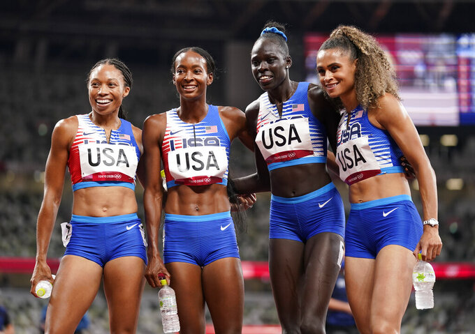 The United States team of Allyson Felix, Dalilah Muhammad, Athing Mu, and Sydney Mclaughlin, from left, celebrate winning the gold medal in the final of the women's 4 x 400-meter relay at the 2020 Summer Olympics, Saturday, Aug. 7, 2021, in Tokyo, Japan. (AP Photo/Charlie Riedel)