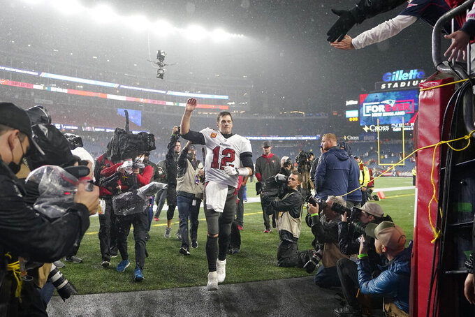 Tampa Bay Buccaneers quarterback Tom Brady (12) waves to fans after defeating the New England Patriots 19-17 in an NFL football game, Sunday, Oct. 3, 2021, in Foxborough, Mass. (AP Photo/Steven Senne)