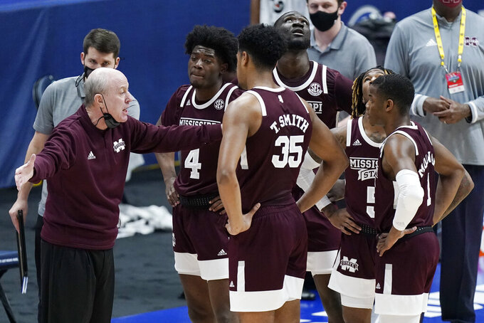Mississippi State head coach Ben Howland talks to his players in the first half of an NCAA college basketball game against Kentucky in the Southeastern Conference Tournament Thursday, March 11, 2021, in Nashville, Tenn. (AP Photo/Mark Humphrey)