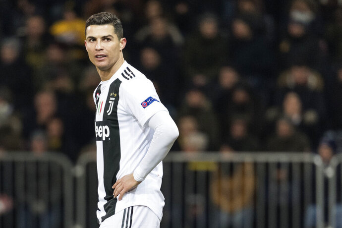 FILE - In this Dec. 12, 2018, file photo, Juventus' Cristiano Ronaldo reacts during the Champions League match at the Stade de Suisse in Bern, Switzerland. Ronaldo is being asked by police in the U.S. to provide a DNA sample in an ongoing investigation of a Nevada woman's allegation that he raped her in his Las Vegas hotel penthouse in 2009, the soccer star's lawyer in Las Vegas said Thursday, Jan. 10, 2019. (Alessandro della Valle/Keystone via AP, File)