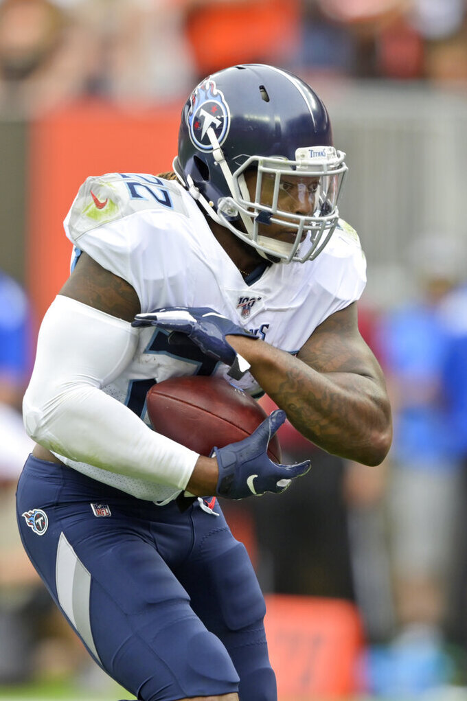 Tennessee Titans running back Derrick Henry rushes for a 1-yard touchdown during the first half in an NFL football game against the Cleveland Browns, Sunday, Sept. 8, 2019, in Cleveland. (AP Photo/David Richard)