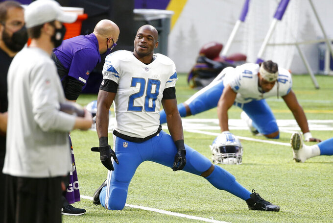 Detroit Lions running back Adrian Peterson warms up before an NFL football game against the Minnesota Vikings, Sunday, Nov. 8, 2020, in Minneapolis. (AP Photo/Bruce Kluckhohn)