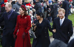 FILE - In this Tuesday, Dec. 25, 2018 file photo, with from left, Britain's Prince William, Kate Duchess of Cambridge, Meghan Duchess of Sussex and Prince Harry, arrive to attend the Christmas day service at St Mary Magdalene Church in Sandringham, England.  Prince Harry will attend the funeral for Prince Philip on Saturday April 17,  the first time that Harry will come face to face with the royal family since he and his wife Meghan, the Duchess of Sussex, stepped away from royal duties last March and moved to California.(AP Photo/Frank Augstein, file)