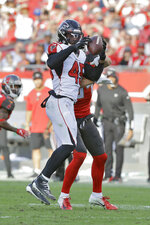 Atlanta Falcons linebacker Deion Jones (45) intercepts a pass intended for Tampa Bay Buccaneers tight end Cameron Brate and returns it for the game-winning score in overtime of an NFL football game Sunday, Dec. 29, 2019, in Tampa, Fla. (AP Photo/Chris O'Meara)