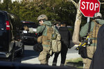 Members of the U.S. Secret Service' Hazardous Agent Mitigation and Medical Emergency Response (HAMMER) Team, move from their vehicle as President Donald Trump is visiting Walter Reed National Military Medical Center, Saturday, Nov. 16, 2019, in Bethesda, Md. (AP Photo/Manuel Balce Ceneta)