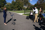 White House director of communications Alyssa Farah talks to reporters outside the White House, Thursday, Oct. 8, 2020, in Washington. (AP Photo/Evan Vucci)