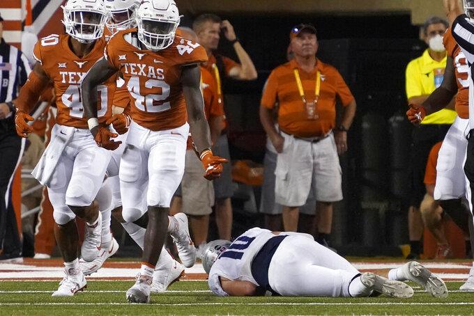 Texas linebacker D.J. Harris Jr. (42) celebrates after sacking Rice quarterback Jake Constantine (10) on the final play of an NCAA college football game on Saturday, Sept. 18, 2021, in Austin, Texas. (AP Photo/Chuck Burton)
