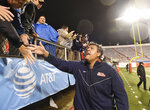 Mississippi coach Matt Luke celebrates with fans after defeating Arkansas in the second half of an NCAA college football game Saturday, Oct. 13, 2018, in Little Rock, Ark. (AP Photo/Michael Woods)