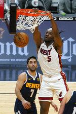 Miami Heat forward Precious Achiuwa (5) dunks the ball over Denver Nuggets guard Facundo Campazzo (7) during the second half of an NBA basketball game, Wednesday, Jan. 27, 2021, in Miami. (AP Photo/Marta Lavandier)