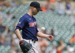 Minnesota Twins starting pitcher J.A. Happ (33) flips a baseball after giving up a two-run home run to Detroit Tigers' Jeimer Candelario during the seventh inning of a baseball game Sunday, July 18, 2021, in Detroit. (AP Photo/Duane Burleson)