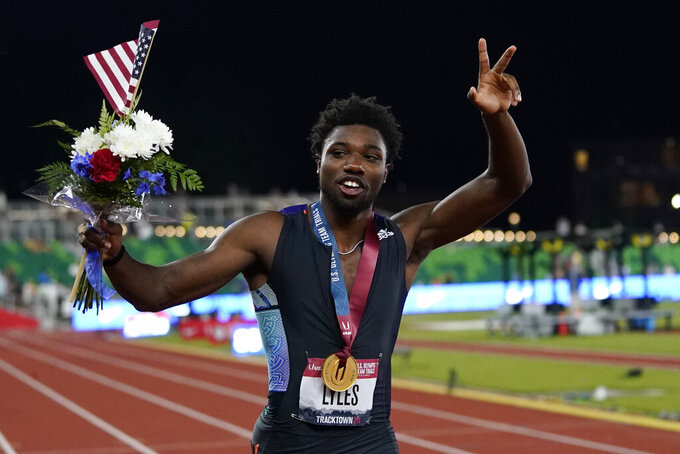Noah Lyles celebrates after winning the final in the men's 200-meter run at the U.S. Olympic Track and Field Trials Sunday, June 27, 2021, in Eugene, Ore. (AP Photo/Ashley Landis)