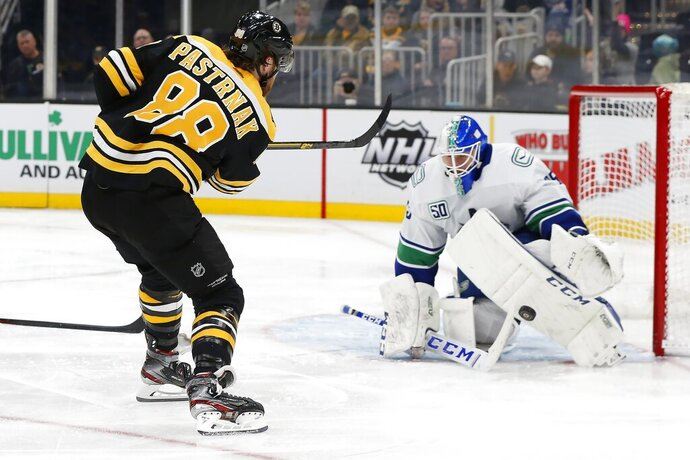 Vancouver Canucks' Jacob Markstrom blocks a shot by Boston Bruins' David Pastrnak (88) during the second period of an NHL hockey game in Boston, Tuesday, Feb. 4, 2020. (AP Photo/Michael Dwyer)