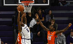 Northwestern center Dererk Pardon (5) fights for a rebound against Illinois center Adonis De La Rosa, left, and guard Da'Monte Williams (20) during the first half of an NCAA college basketball game on Sunday, Jan. 6, 2019, in Evanston, Ill. (AP Photo/Matt Marton)