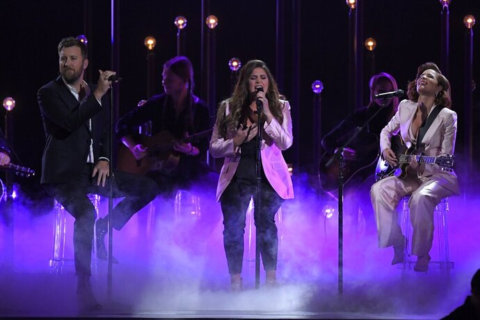 Charles Kelley, left, and Hillary Scott, center of Lady Antebellum perform