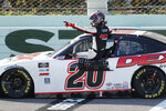 Harrison Burton gets out of his car after winning a NASCAR Xfinity Series auto race Saturday, June 13, 2020, in Homestead, Fla. (AP Photo/Wilfredo Lee)