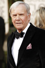 FILE - Tom Brokaw arrives at the 66th Annual Golden Globe Awards in Beverly Hills, Calif. on Jan. 11, 2009. Brokaw says he is retiring from NBC News after working at the network for 55 years. The author of
