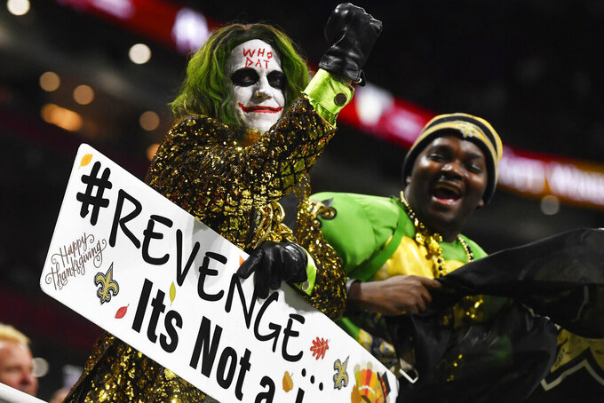 New Orleans Saints fans cheer during the first half of an NFL football game against the Atlanta Falcons, Thursday, Nov. 28, 2019, in Atlanta. (AP Photo/John Amis)