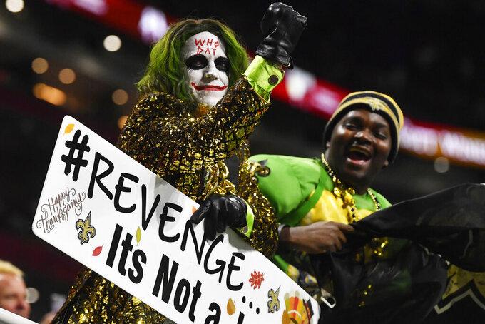 New Orleans Saints fans cheer during the first half of an NFL football game against the Atlanta Falcons, Thursday, Nov. 28, 2019, in Atlanta. (AP Photo/John Amis)