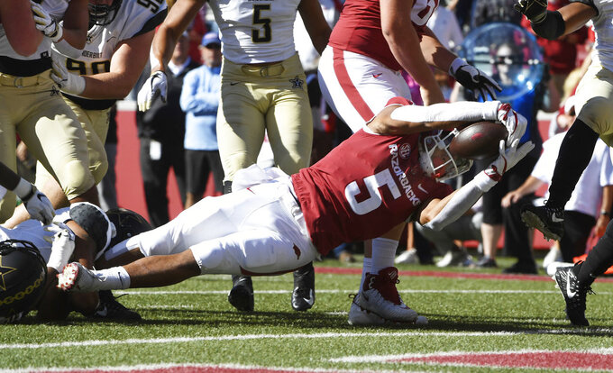 Arkansas running back Rakeem Boyd dives into the end zone to score a touchdown against Vanderbilt in the first half of an NCAA college football game Saturday, Oct. 27, 2018, in Fayetteville, Ark. (AP Photo/Michael Woods)