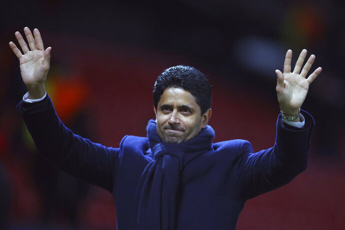 FILE - In this Tuesday, Feb. 12, 2019 file photo, Paris Saint Germain owner Nasser bin Ghanim Al-Khelaifi waves to teams fans at the end of their soccer match against Manchester United at Old Trafford stadium in Manchester, England. Qatari soccer and television executive Nasser al-Khelaifi will go on trial starting Sept. 14, 2020 in Switzerland in September, implicated in providing a holiday villa to a FIFA official linked to a World Cup broadcasting deal. The court has listed 10 days in September to hear the case against al-Khelaifi, former top FIFA official Jerome Valcke and another broadcasting executive who was not identified. (AP Photo/Dave Thompson, file)